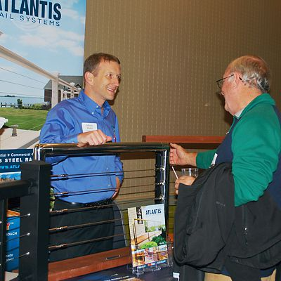 Guest speaking to the Atlantis Rail Systems representative at Contractor Appreciation Night