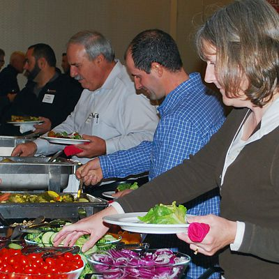 Guests serving themselves from the buffet at Contractor Appreciation Night